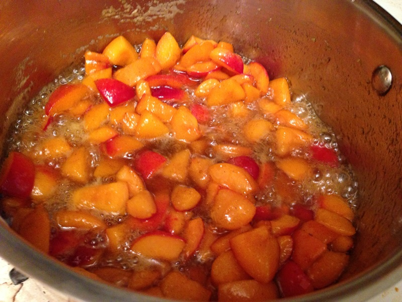 Macerated apricots simmering in bourbon syrup