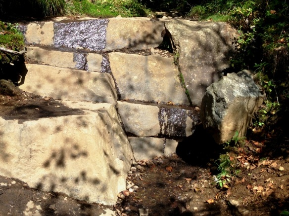 Water cascading down natural stone steps
